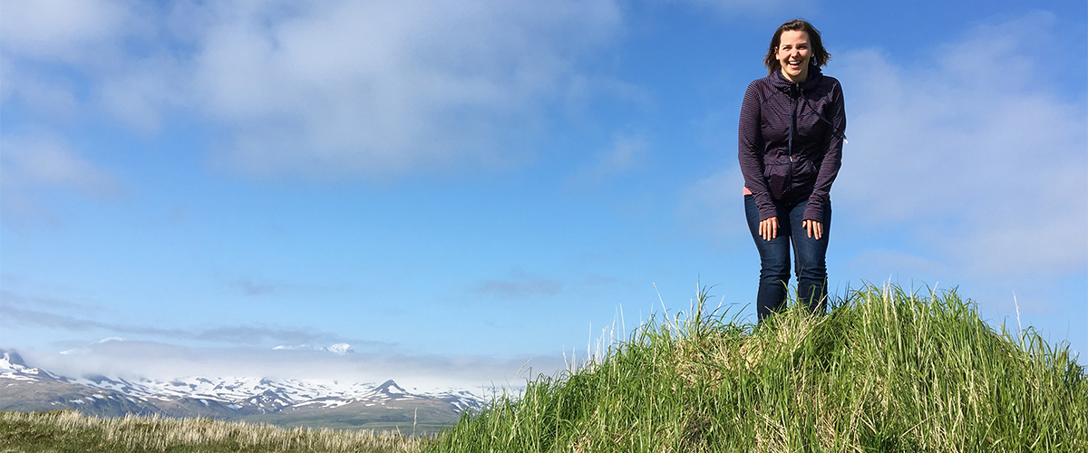 Robyn Giffen at the top of a tiny mountain in Atka, Alaska Featured