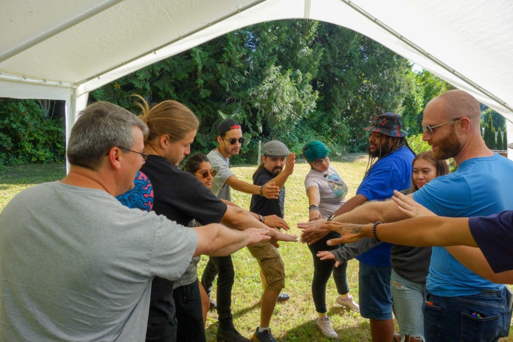 WAYK participants and the Sḵwx̱wú7mesh language team prepare for an energizer during the 2020 Summer Language Intensive in North Vancouver, British Columbia.